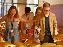 """Participants interact with """"Almost Disney"""" at the TEDxYouth@Lincoln event on Aug. 11. Photo by Michael Reinmiller."""