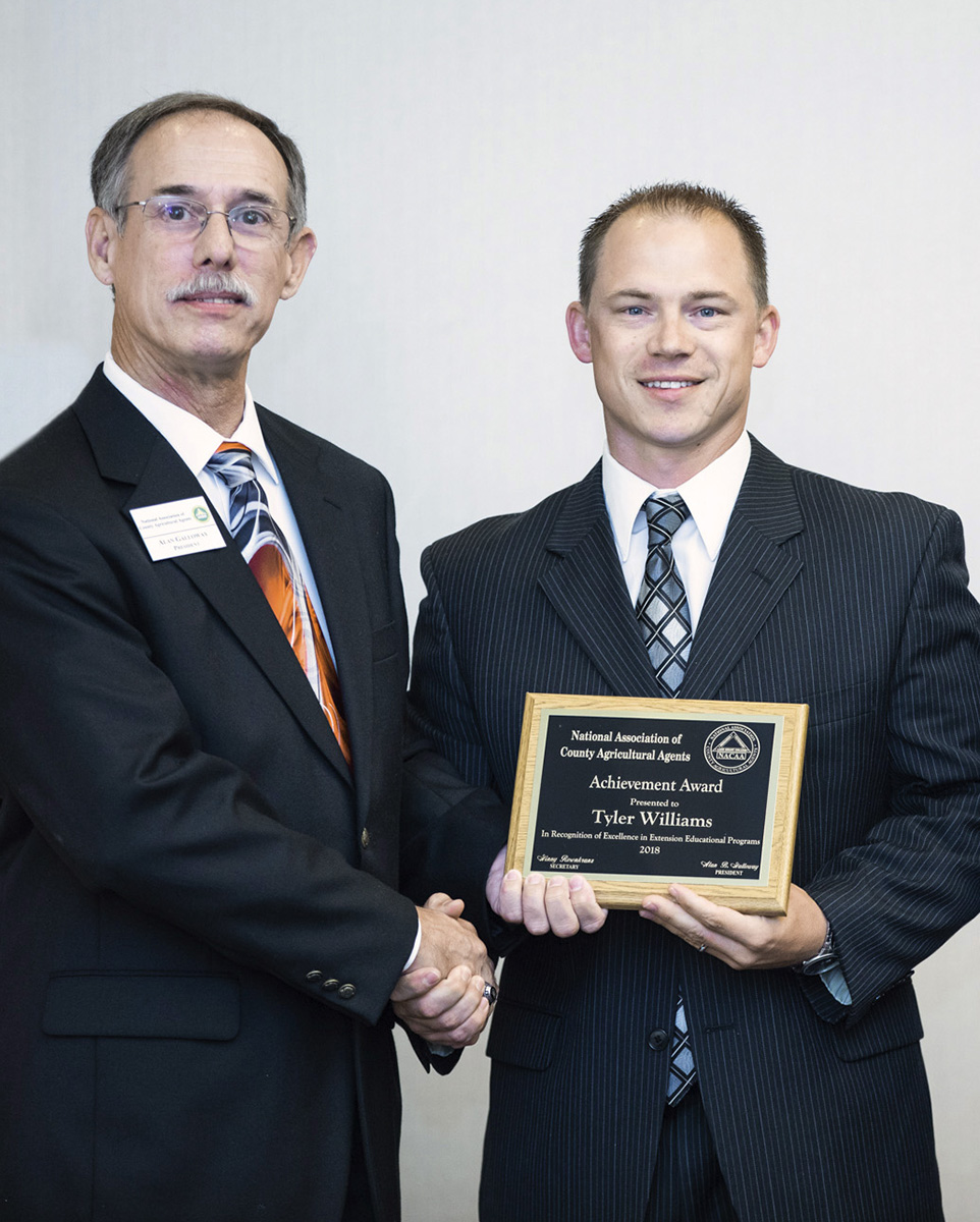 (L–R) NACAA President Alan Galloway with Tyler Williams.