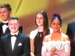 Candace Nelson (back row, third from left) on stage at the Emmy Awards.