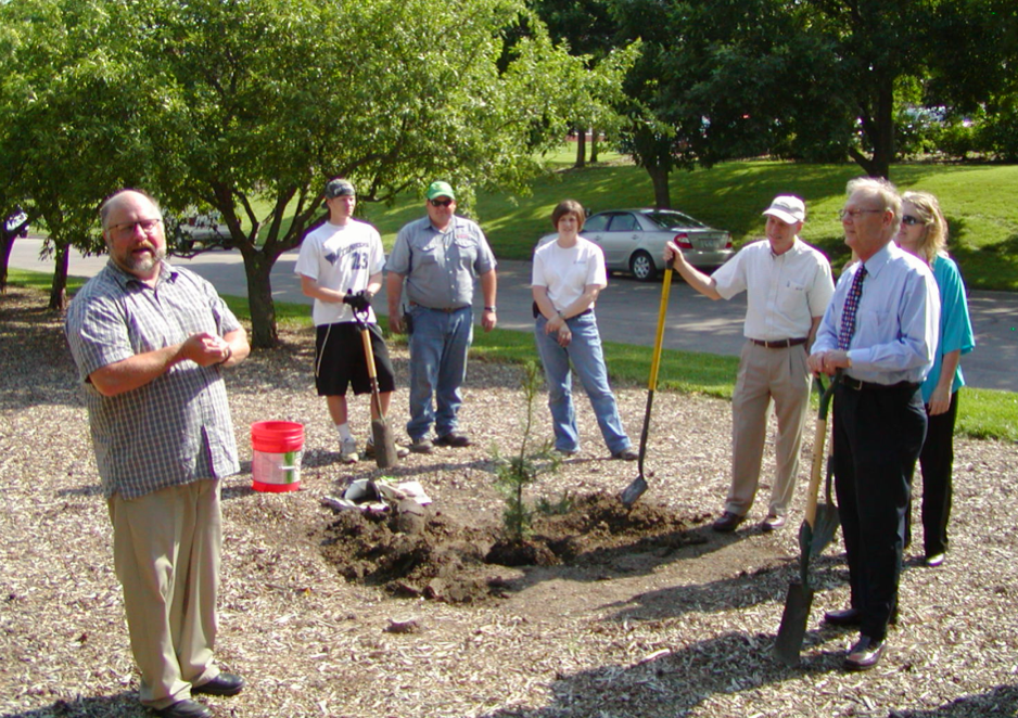 Faculty and staff say a few words about former SNR director Ted Elliott at a tree planting in his honor.