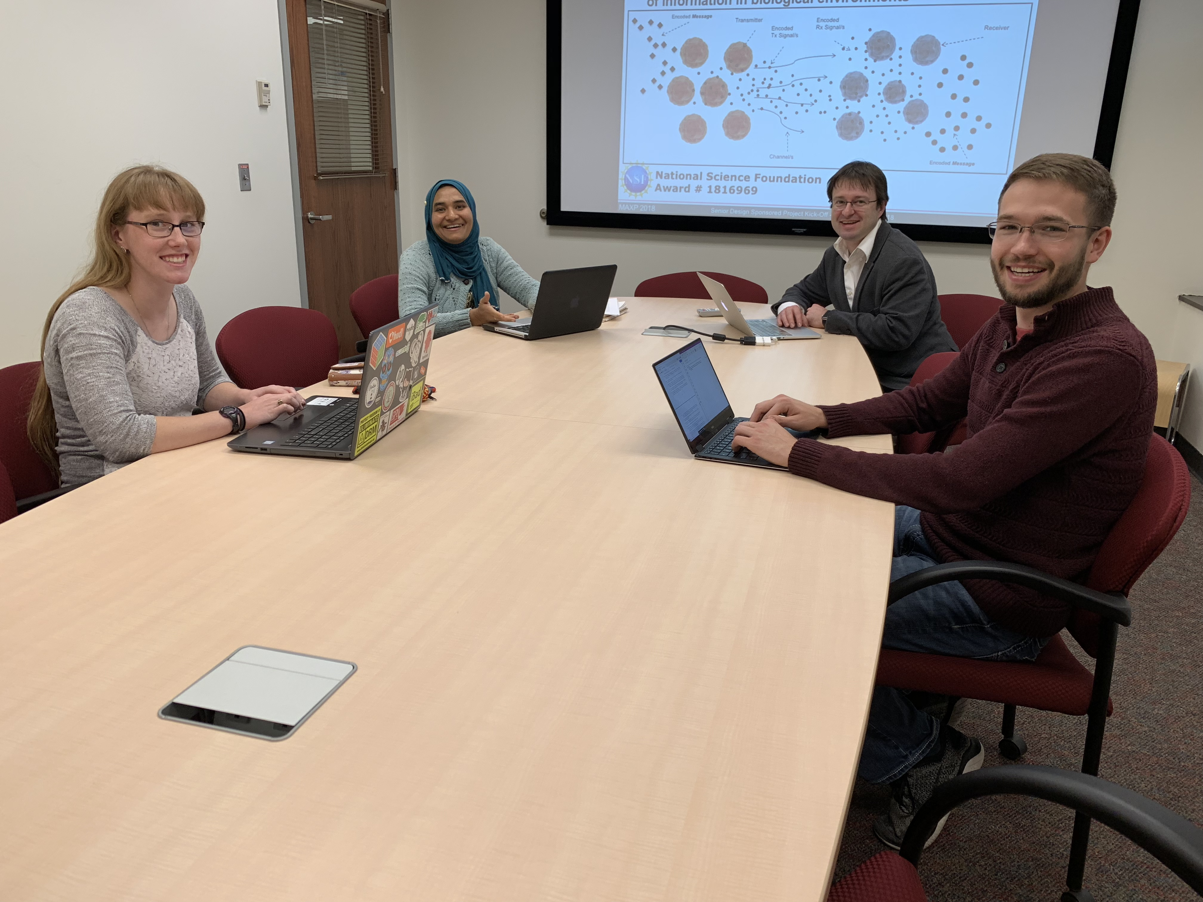 The WetComm project team from left to right: Molly Lee, Zahmeeth Sakkaff, Massimiliano Pierobon, and Colton Harper.