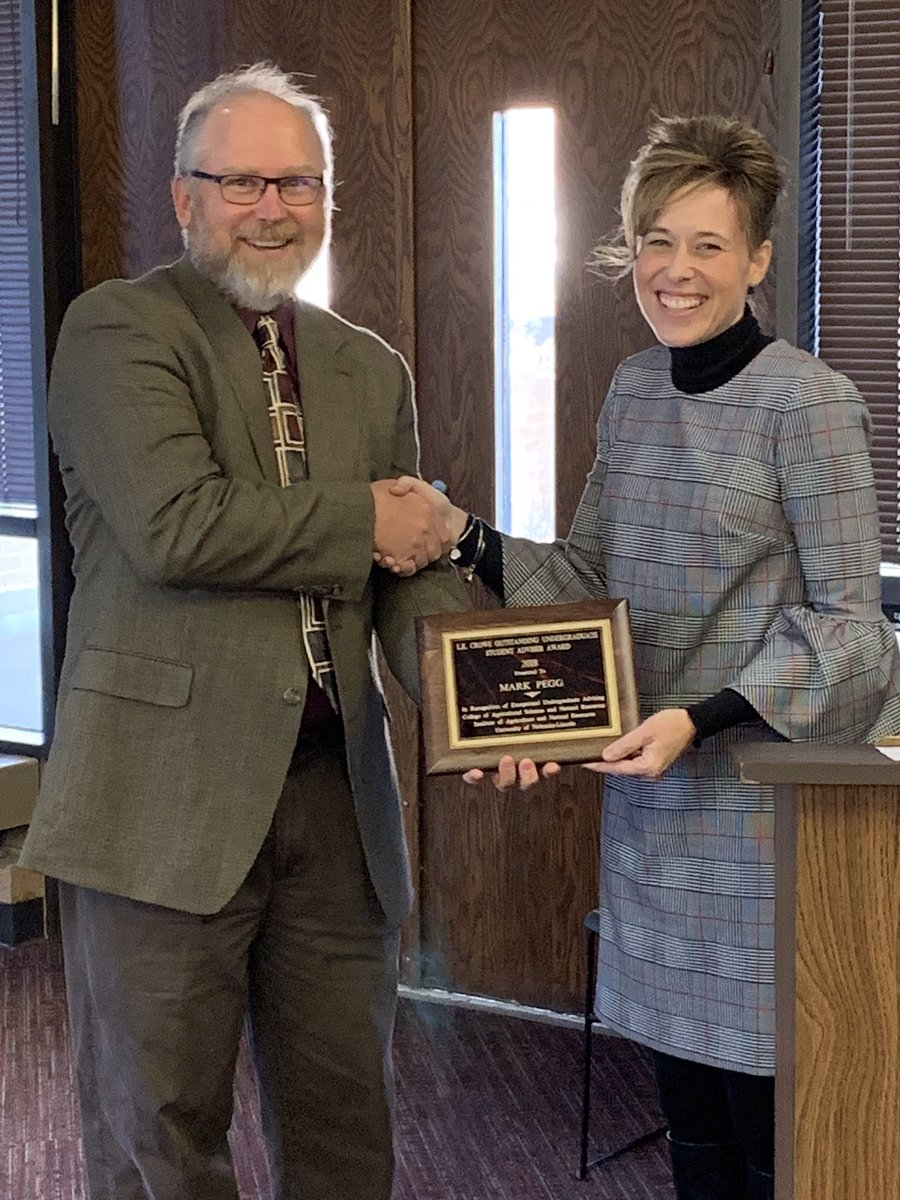 Mark Pegg accepts the Lawrence K. Crowe Outstanding Undergraduate Advising Award. | Courtesy image