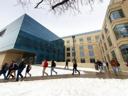 Nebraska students walk by Howard Hawks Hall after snow fell earlier this semester. The university issues messages about winter-related closures via the UNL Alert system.