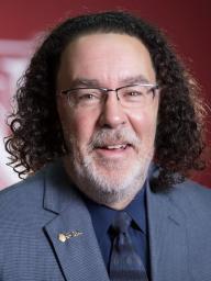 Director Dann Husmann