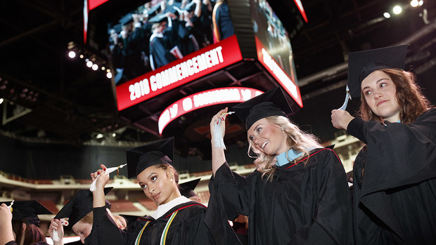 Virginia Hill (left), Master of Arts in political science; Hillary Hotz (center), Master of Arts in educational administration; and Melissa LaRosa (right), Master of Arts in educational psychology; move their tassels at the end of the graduate and profess