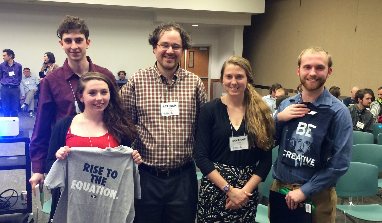 Patrick Rault (center) with SUNY Geneseo students who won the Math Jeopardy contest at CURM national / MAA regional conference in Utah in 2015.