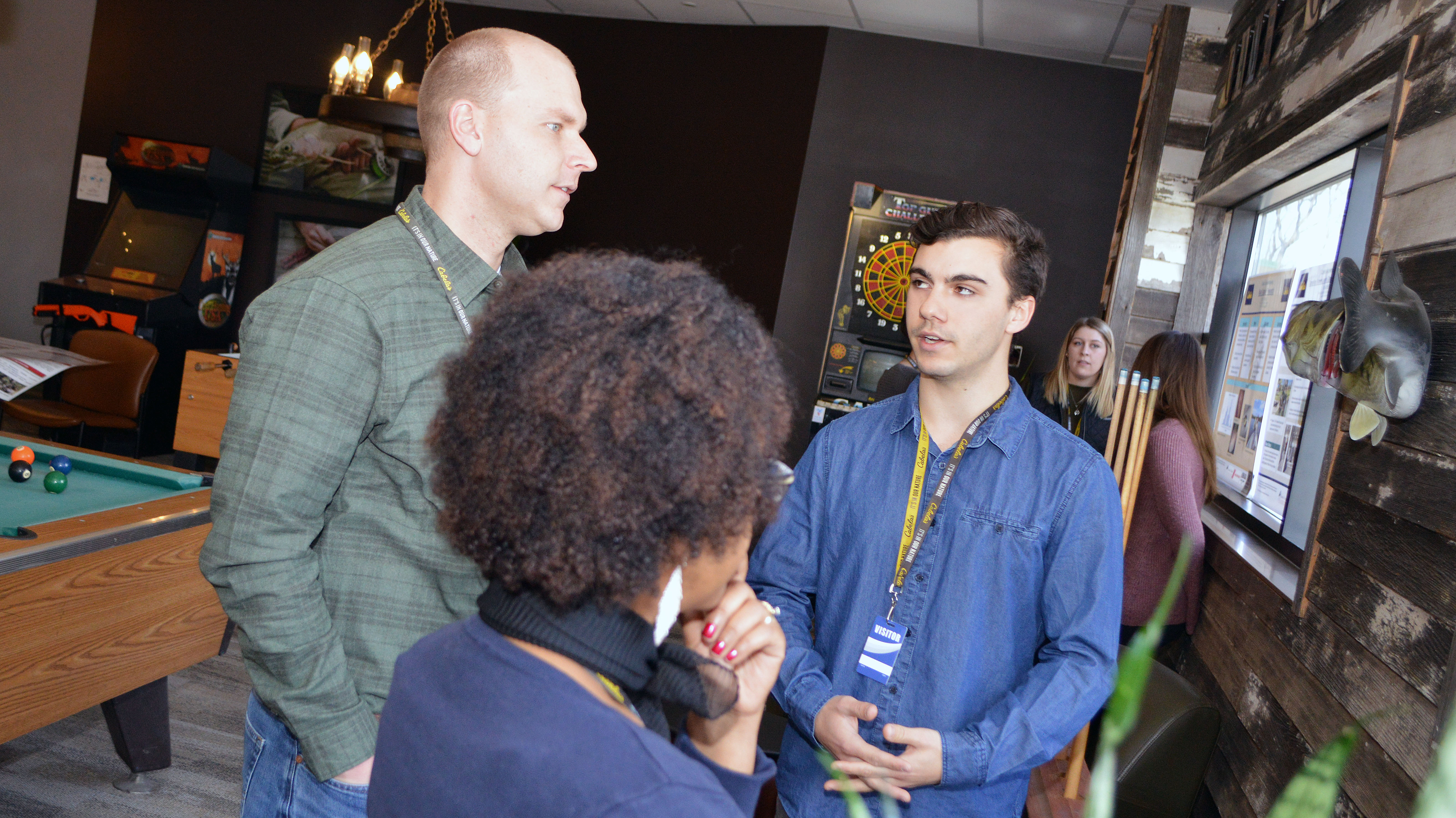 Mike True presents his work to Cabela's staff during the 2018 Cabela's Apprenticeship Poster Session at the outdoor store's headquarters in Lincoln. | Shawna Richter-Ryerson, SNR