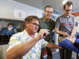 Nebraska researchers Steven Barlow, (near left) and Greg Bashford (center) have developed a system to treat stroke victims using a functional transcranial Doppler ultrasound and somatosensory stimulation. Doctoral students Jacob Greenwood (far left) and B