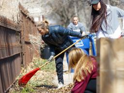 Huskers rake help rake leaves in a Lincoln neighborhood during the 2018 Big Event. The annual community service event, which is part of a national program, will be held April 6. Registration is open through March 8. | Craig Chandler, University Communicat