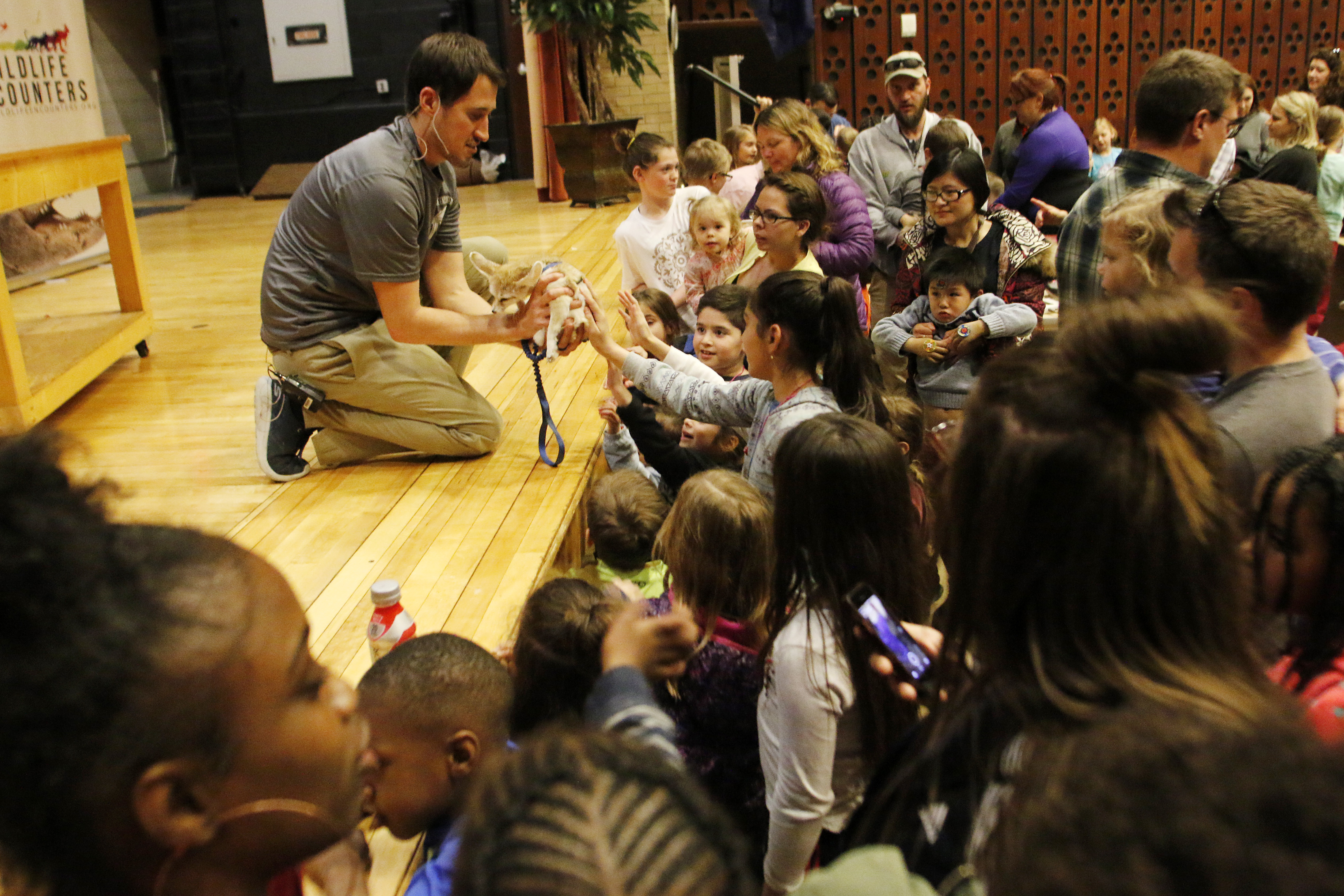 Kip Smith lets the crowd pet the fennec fox after the Wildlife Encounters educational show during the 2018 CASNR Week festivities Tuesday, April 17, 2018, at the School of Natural Resources at the University of Nebraska-Lincoln. | Natural Resources file p