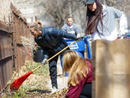 Huskers rake help rake leaves in a Lincoln neighborhood during the 2018 Big Event. The annual community service event, which is part of a national program, will be held April 6. Registration is open through March 8.