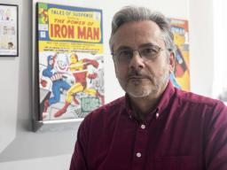 Dan Claes poses for a portrait with his comic memorabilia in his office in Jorgensen Hall on Thursday, Feb. 28, 2019, in Lincoln, Nebraska. Photo by Jackson Wilford