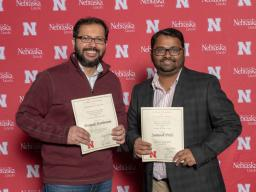 Associate Professor of Biological Systems Engineering, Deepak Keshwani, and Assistant Professor, Advanced Machinery Systems, Santosh Pitla smile with their awards at the annual Parents' Recognition Award Ceremony. Photo by Greg Nathan.