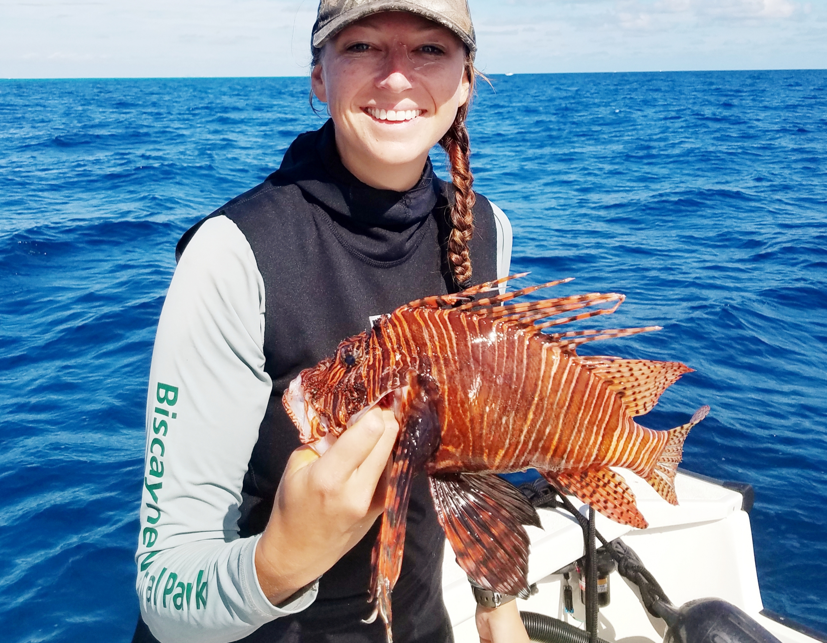 Brown with an invasive lionfish