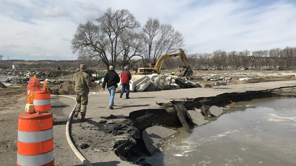 Nebraska officials assess road damage caused by recent flooding. | Courtesy Courtesy Nebraska Emergency Management Agency