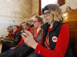 """Husker Tia Rasmussen takes a photo of the legislative session while attending the """"I Love NU"""" Advocacy Day at the State Capitol in 2018. The event was attended by several hundred students, staff, faculty, alumni and friends of the NU system. 