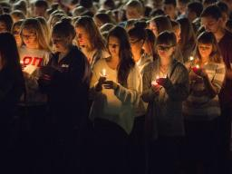 Students participate in a candlelight vigil honoring Keaton Klein and Clayton Real in 2014. The university will honor students, faculty, staff and alumni who died during the current academic year in 2015. | University Communication file photo. |
