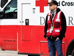 Journalism student Kenneth Ferriera interviews Red Cross Disaster Services volunteer Joel Olavarrio outside a shelter in Fremont.