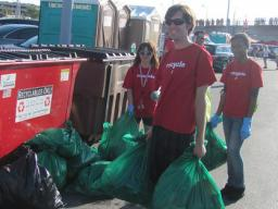 Go Green for Big Red Volunteers collect recycling bags during a Husker football game. The recycling initiative, which focuses on reducing trash created via football game tailgates, is among successes for the university's sustainability programs. | Univer