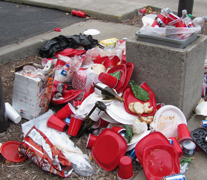 Tailgaters can help UNL volunteers collect recyclables at Stadium lots to avoid messes like this from last year.