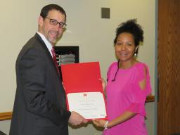 Lisbeth Vallecilla Yepez is honored with a Milton E. Mohr Fellowship by Dan Linzell, associate dean for graduate and international programs.