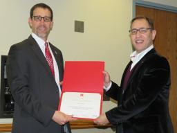 Bora Pulatsu receives a certificate for Outstanding Graduate Teaching Assistant from Daniel Linzell, associate dean for graduate and international programs.