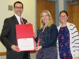 Amy Mantz (center) receives a certificate from the Graduate Student Poster competition at the Spring Research Fair. The certificate was presented by Daniel Linzell (left), associate dean for graduate and international programs, and Angela Pannier, profess
