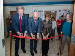 Members of the Wright family — daughter Bunny (second from right), grandson Eric Gardner (second from left) and Bunny's husband, Jonathan (left) — cut a ceremonial ribbon as department chair Tracy Frank (right) looks on. Greg Nathan | University Communica