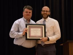 Mark Wilkins (left) presents the Elenore Gakemeier Swarts Outstanding Doctoral Graduate Student Award to Eric Farris (right)