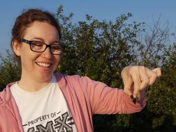 Alison Ludwig holds an American burying beetle. Courtesy Nebraska NRT Program