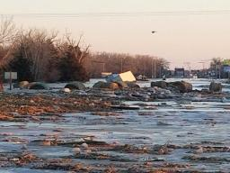 Cornstalks and hay bales displaced by ice-covered flood waters on March 14 near Columbus. (Photo courtesy of Jeff Berggren)