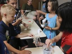 "Youth built bridges with straws and tape, then tested how much weight the bridges could hold until they collapsed in the ""Amazing Engineering 1"" workshop presented by staff and students from the UNL College of Engineering. (Photo by Vicki Jedlicka)"