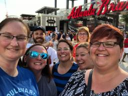 OPS teachers attend Atlanta Braves game (far left Mary Kate Thraen, center Jessica Korth, back row right Lynn West and far right Tanya Archie)