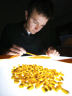 Assistant professor David Holding analyzing corn kernels.