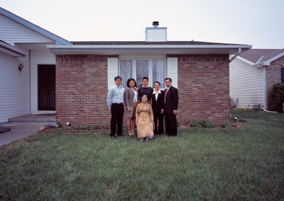 Binh Danh's photo of Mary Nguyen's family in front of home, 2011. Archival pigmented print.