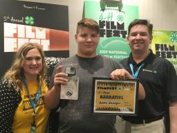 """Riley Peterson (center) earned 3rd place for his narrative video, """"Game Changers"""""""