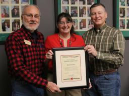 Paula Peterson (center) with Nebraska Association of County Extension Boards Metro District representative Wes Daberkow (left) and Extension Board Vice President Chris Scow (right). Not pictured is Allen Blezek.