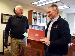 Rick Perk, left, geoscientist with the Center for Advanced Land Management Technologies at the School of Natural Resources, retired Dec. 20, 2019, with a small reception in Hall Hall. Director John Carroll hands him a memento marking the occasion.