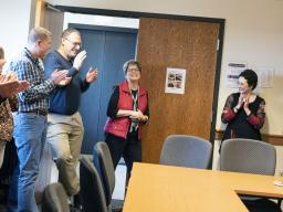 The NDMC staff gives Ann Fiedler a round of applause during her surprise retirement reception in Dec. 19, 2019, in Hardin Hall. | Shawna Richter-Ryerson