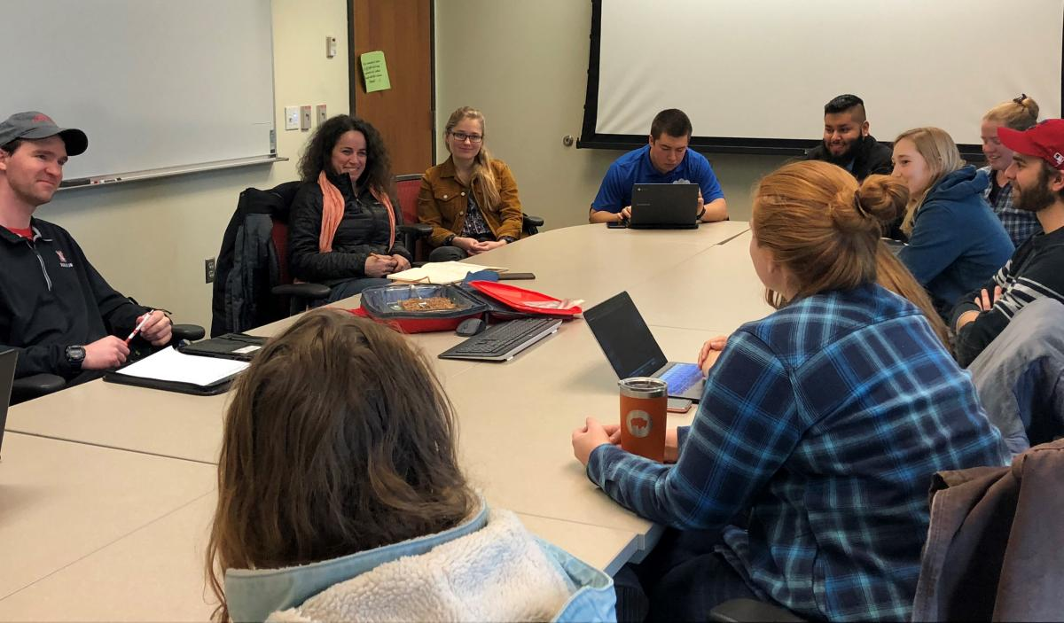 Elena Bennett (second to left) visited NRT students at their biweekly meeting, talking about their work and the importance of persistence and effective communication to have impact.