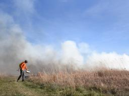 Nick Hoeven, senior fisheries and wildlife major, participates in a training burn at Nine-Mile Prairie in 2019. | Shawna Richter-Ryerson, Natural Resources