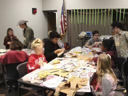 The craft committee led in making paper-bag safari vests, paper-plate-and-bowl safari hats, toilet-paper-tube binoculars and animal masks.