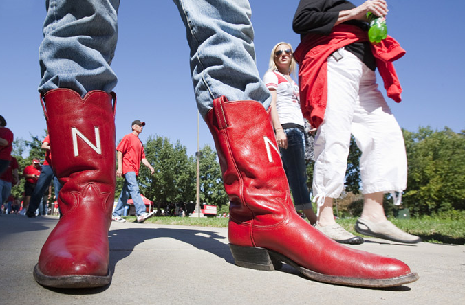 Russell Headlee, a senior from Lincoln, shows off a shiny red pair of boots before the Huskers' season opener with Western Kentucky University. Headlee said he bought the boots on Ebay last winter. Photo by Craig Chandler, University Communications
