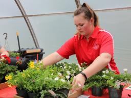 Horticulture club members, Morgan Von Seggern (left) and Haley Donaldson prepare flats of plants for customers at the 2019 spring sale.