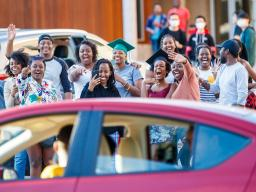 Members of the University of Nebraska–Lincoln community and Christ Place Church celebrated the achievement of graduating Rwandan scholars with a parade on May 8. Credits: Craig Chandler, University Communications