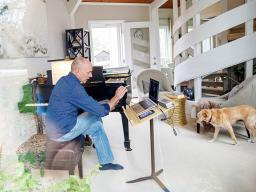 Nebraska's Paul Barnes sits at the Steinway piano in his home while teaching a one-on-one lesson with student Cameron Berta, who returned home to Dallas in the wake of the university's shift to remote instruction. Credit: Craig Chandler.