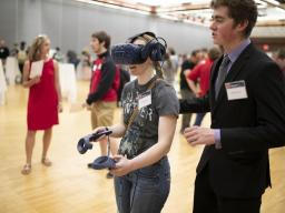 A student demos a VR project at the 2019 Senior Design Showcase.
