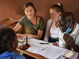 "Two University of Nebraska–Lincoln students sit in on a local meeting during their ""Food Security, Health and Nutrition"" program in Zambia and Ethiopia in summer 2019. Led by Mary Willis, the study abroad program has included 15 Husker Gilman Scholars sin"