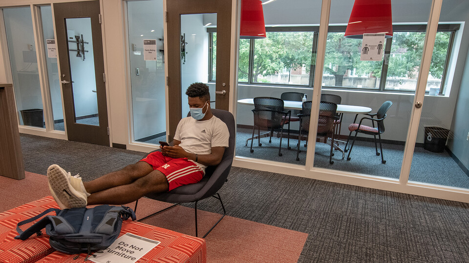 Tedum Npimnee, a junior international business major, waits for an appointment in the new Husker Hub office in Canfield Administration Building. Previously located in Pound Hall, Husker Hub recently moved into its remodeled space.