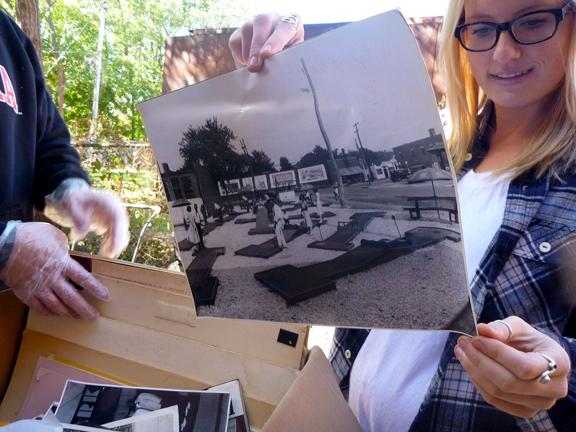 Students examine a historic North Omaha photo.